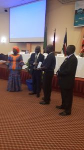 Dr. Justine Chisenga receiving his award at ongoing 2018 SCECSAL in Entebbe, Uganda.