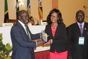 LIAZ Secretary General receiving the award for Prof. Maurice .C Lundu